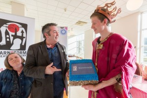 Youth Theatre cast member Brian O' Reilly presents Philip with the cake!