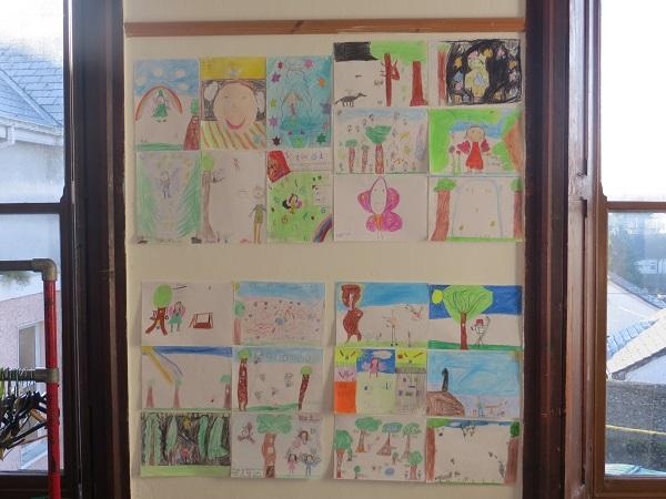Photo of children's fairy-folk designs pinned on wall